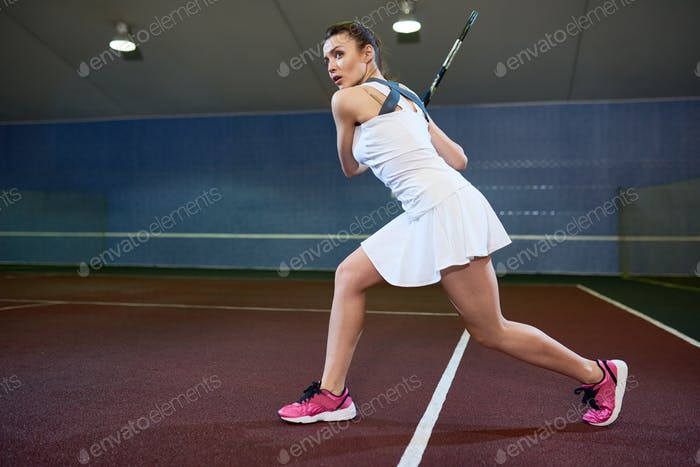 Woman at Tough Tennis Practice