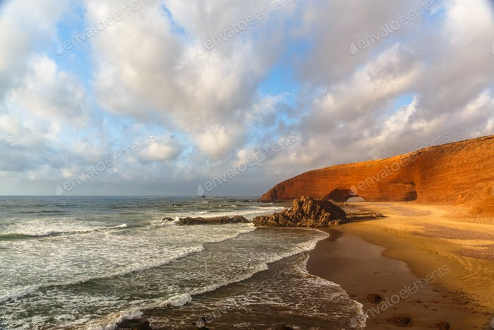 Sunset in Legzira beach with red arch, Atlantic ocean, Sidi Ifni
