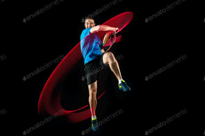 one caucasian man playing tennis player on black background