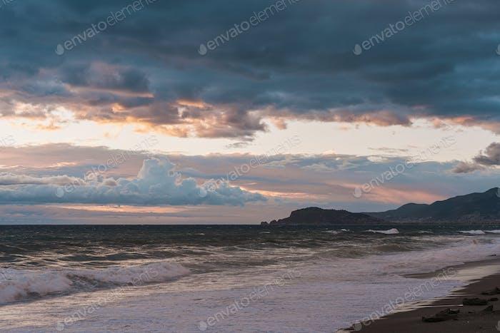 Seashore during bright sundown, sunset on seaside