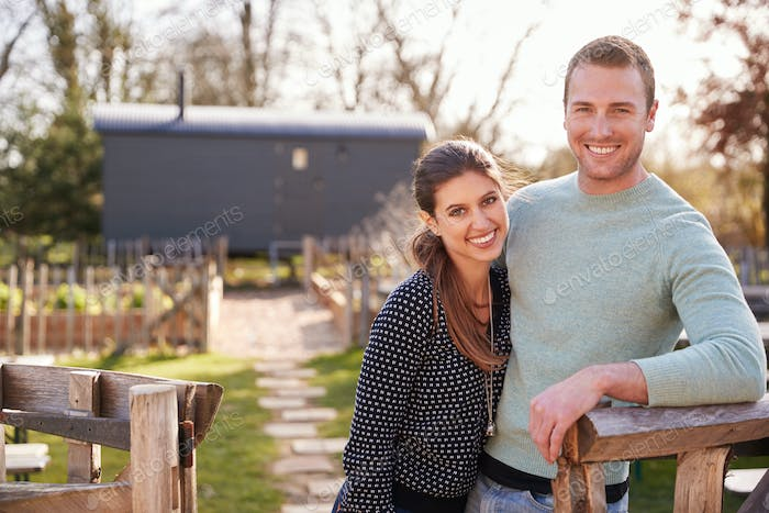 Outdoor Portrait Of Couple Spending Vacation In Eco Lodge