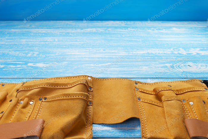 tool belt on wooden table background