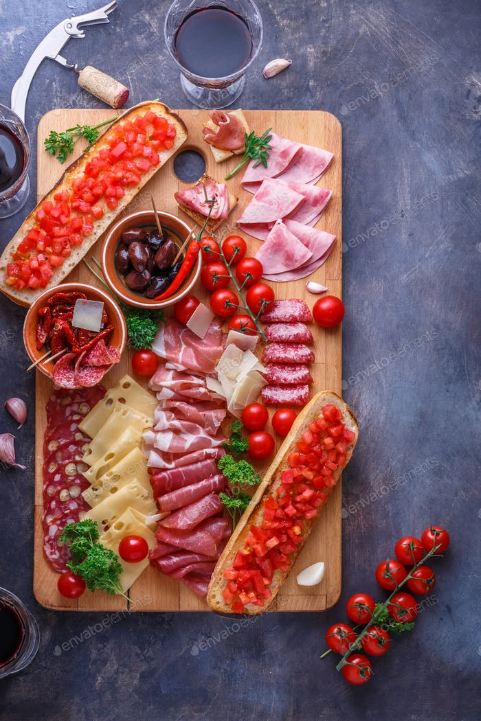 Meat antipasto board on stone table. Top view with copy space.