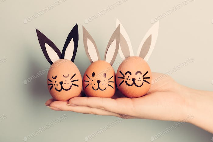 Three little Easter bunnies made from an egg