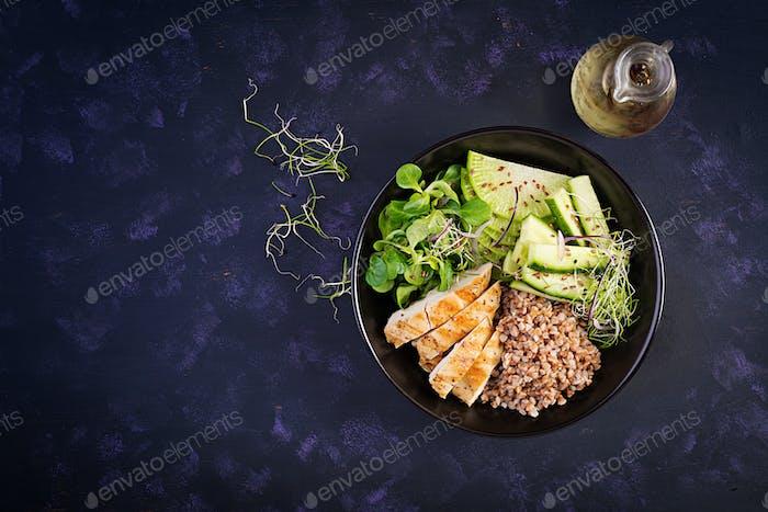 Lunch salad. Buddha bowl with buckwheat porridge, grilled chicken fillet, corn salad