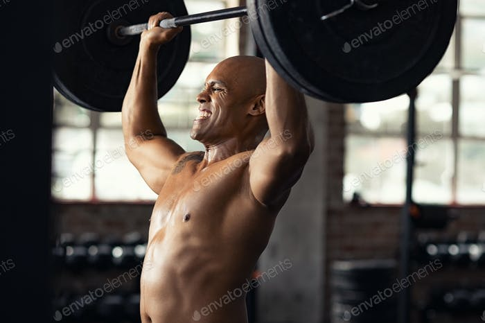 Strong black man doing weight lifting