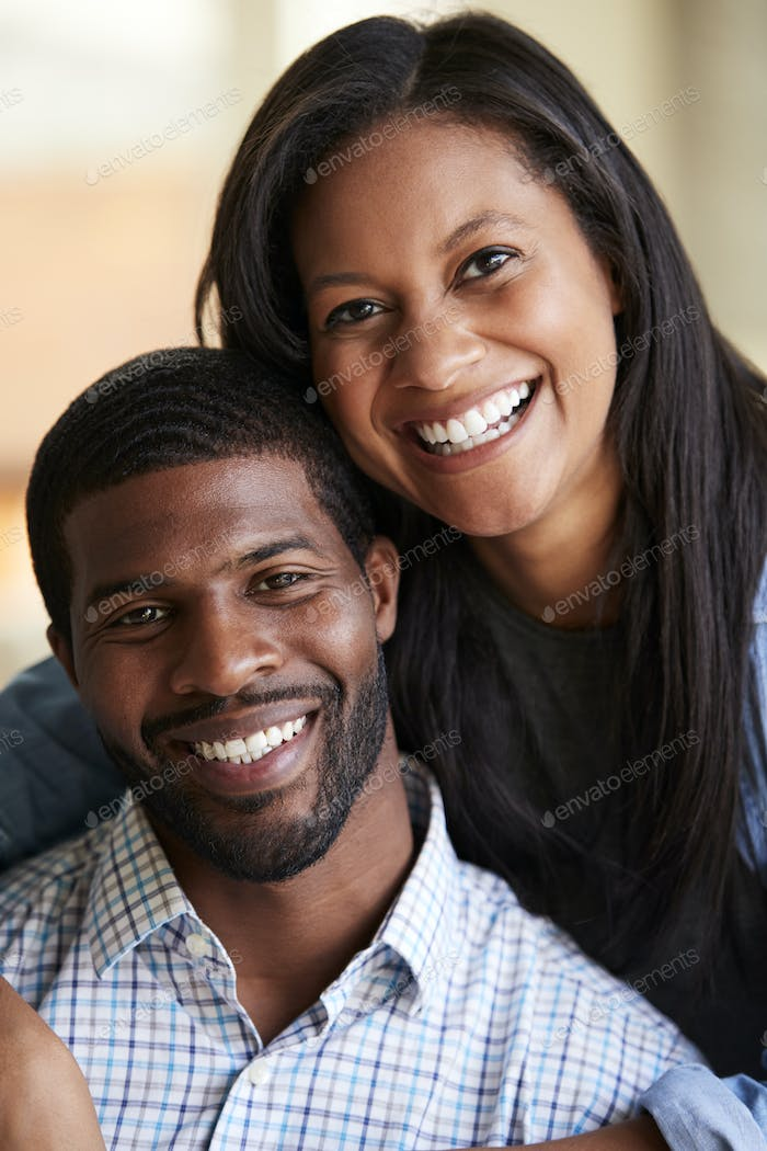 Portrait Of Smiling Loving Couple Hugging At Home