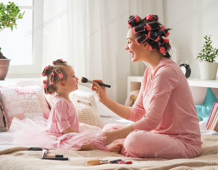 Mom and child doing hair