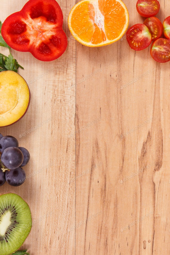 Frame of fresh ripe fruits and vegetables as healthy eating, place for inscription on plank