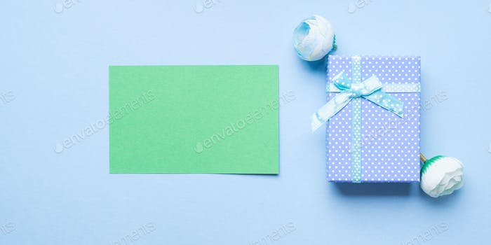 Green greeting card and gift box