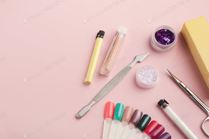 Manicure supplies on pink background