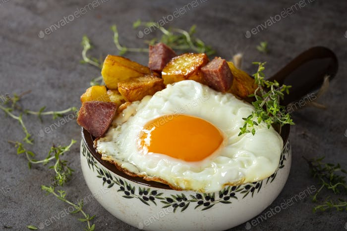 Egg with fries and fried salami