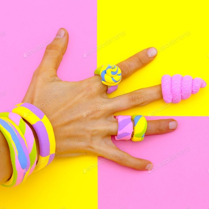 Hand in candy accessories. Minimal sweet mood