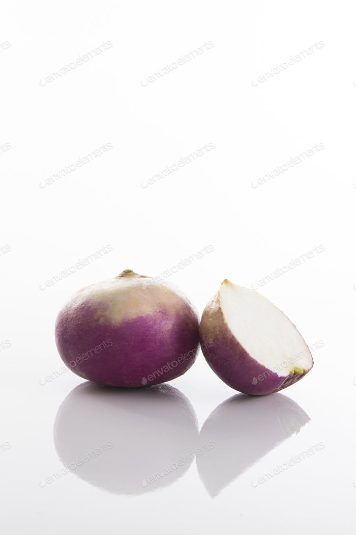 Fresh radish on a white surface with a white background