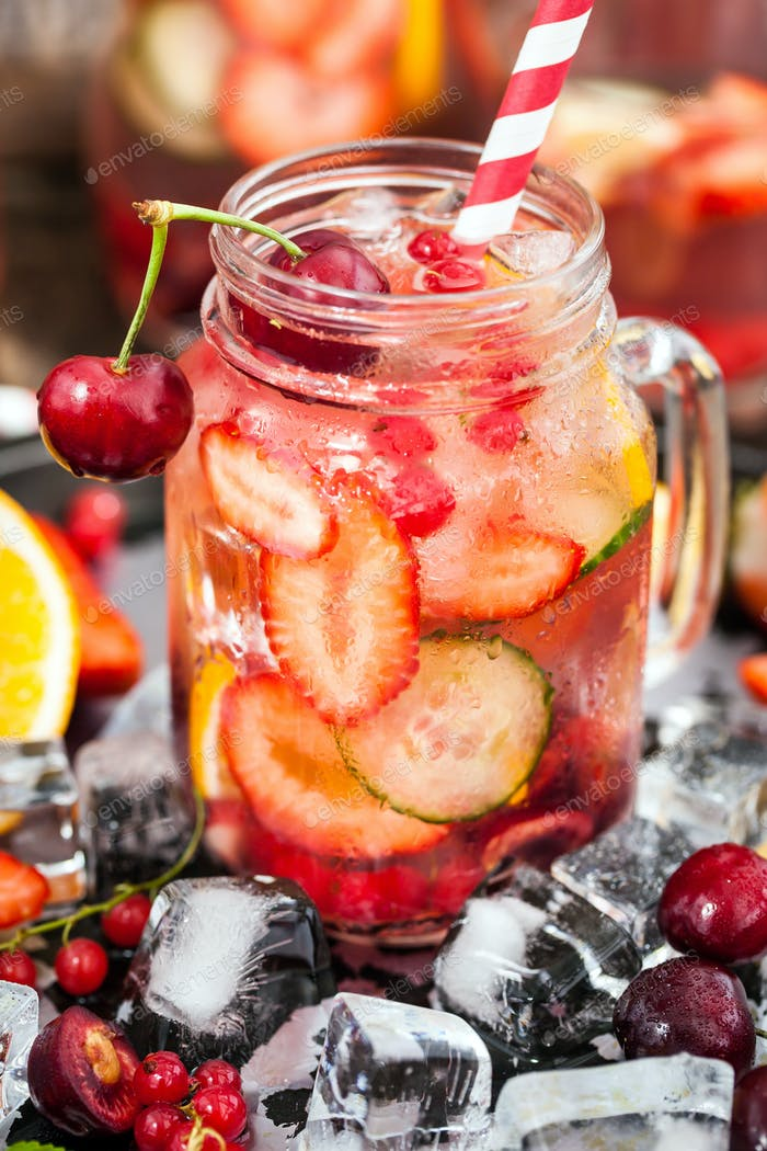 Healthy infused detox water with fresh berries and fruits