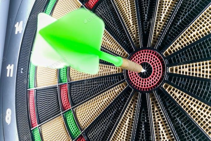 Close-up on dart pin on board bullseye