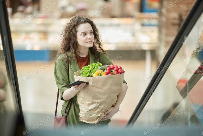Young Woman Leaving Grocery Store