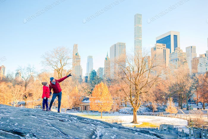 Family of father and kid in Central Park during their vacation in New York City