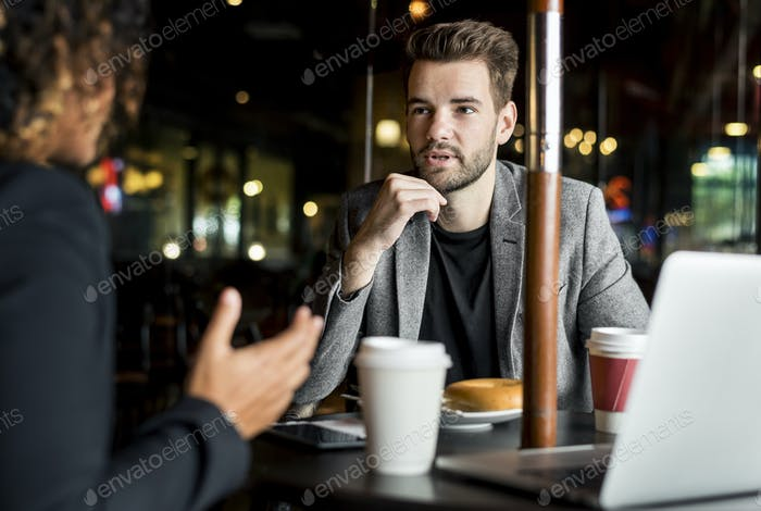 Business partners working together at a cafe