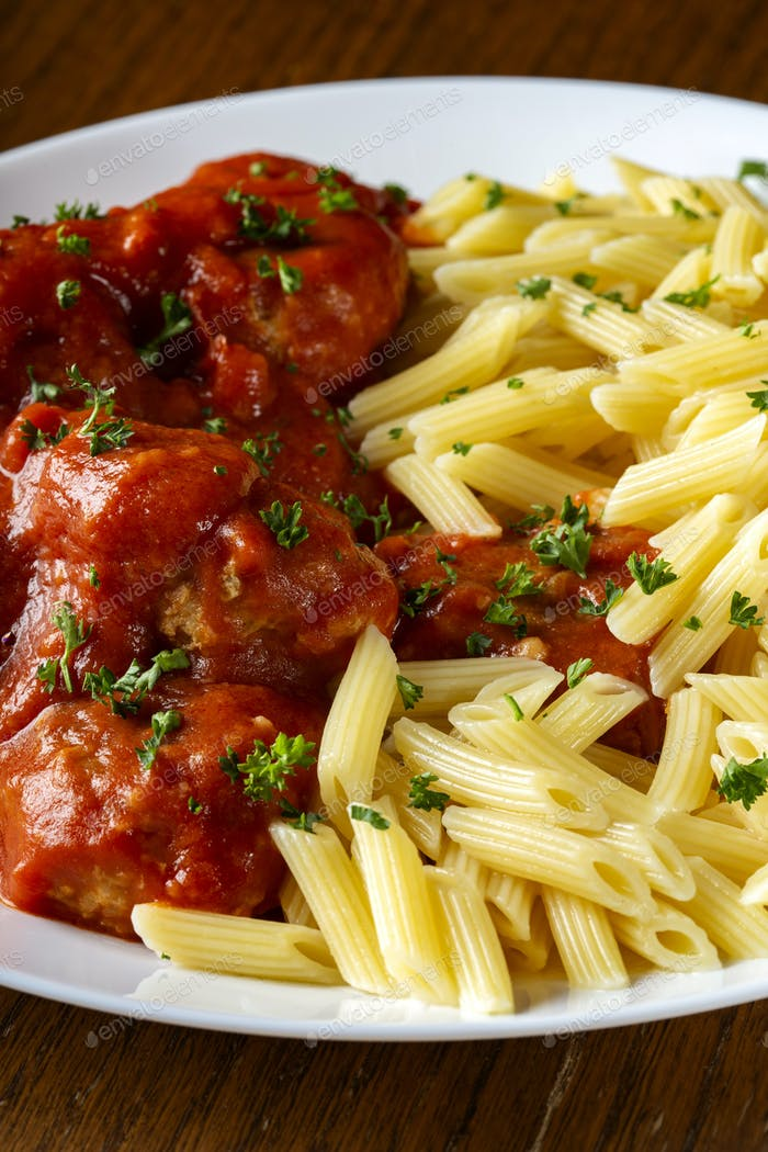Meatballs in tomato sauce with small penne pasta