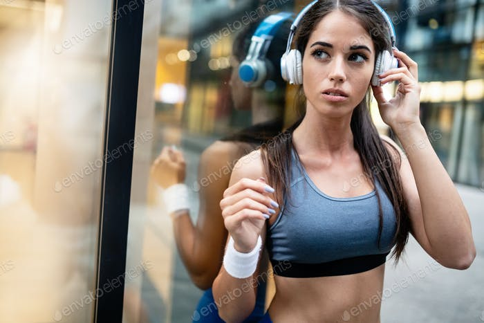 Picture of young attractive happy fitness woman outdoor