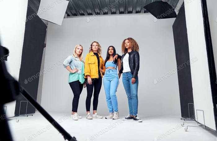 Studio Shot Of Young Independent Multi-Cultural Female Friends On Photo Shoot