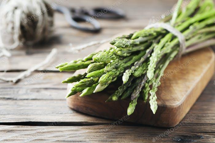 Fresh wild asparagus on the wooden table