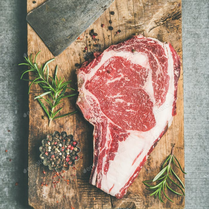 Raw prime beef meat steak rib-eye and chopping knife, flat-lay