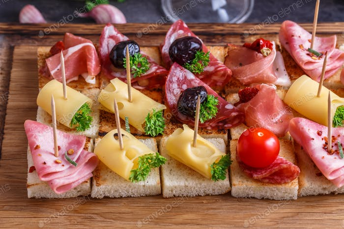 Close view pintxos, tapas, spanish canapes party finger food