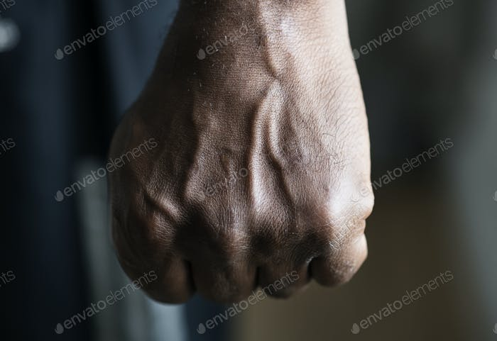 Closeup of a black hand in fist