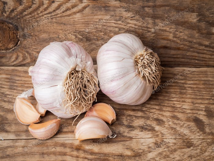whole tubers and garlic cloves on a wooden table, a natural antiseptic.