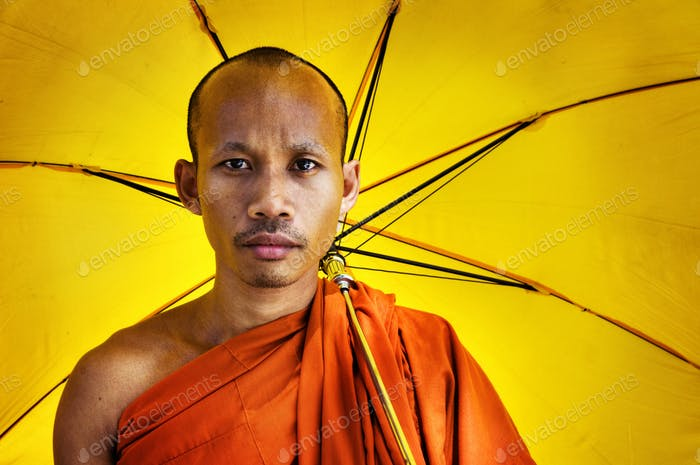 Buddhist Monk Holding Umbrella