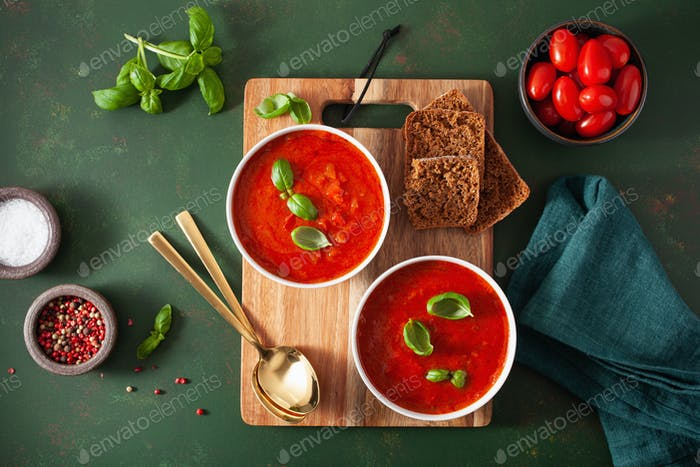 tomato and bell pepper vegetarian soup on green background