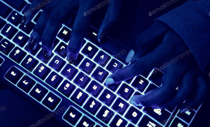 Closeup of hands using a keyboard