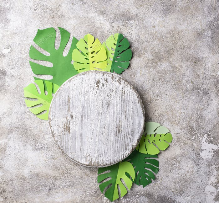Background with tropical palm leaves monstera from paper