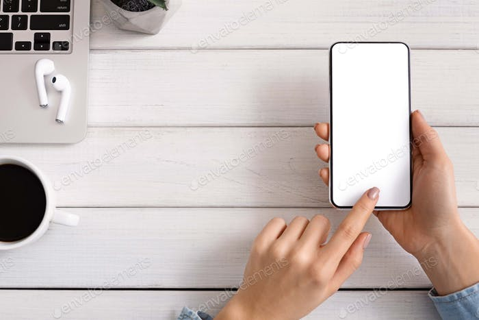 Woman using smartphone with blank screen testing new app