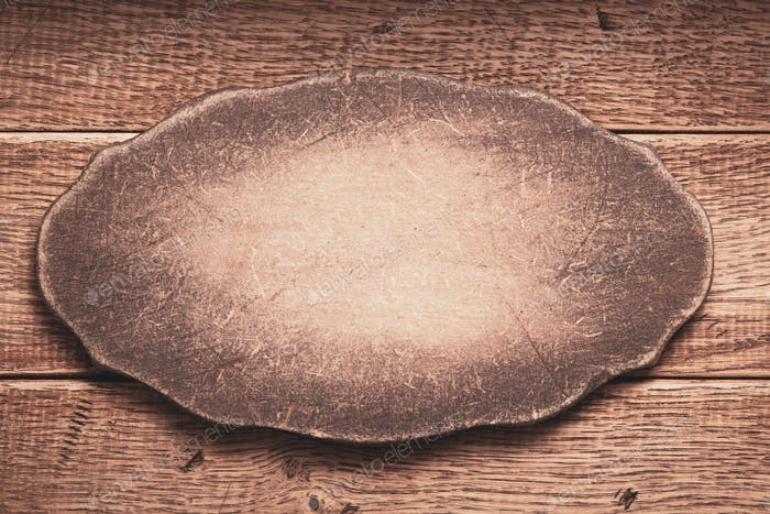 aged wooden nameplate at wood board background