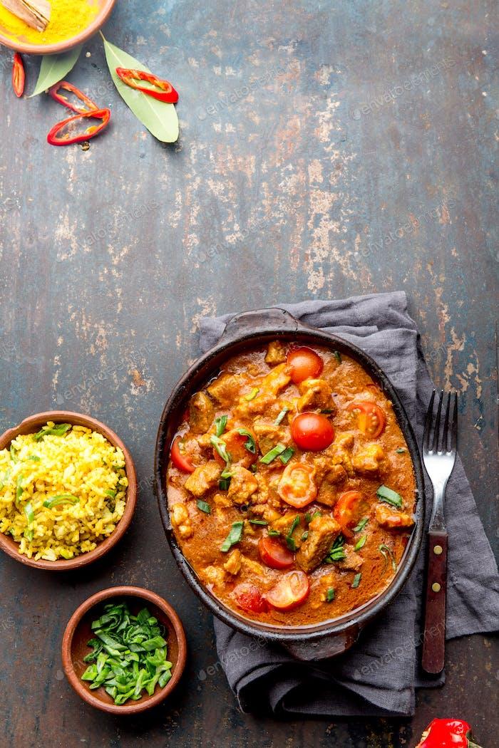 INDIAN FOOD. ROGAN JOSH curry sauce. Pork rogan josh with rice.