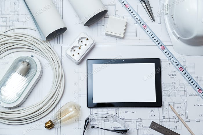 Construction drawing with tools and tablet with blank screen