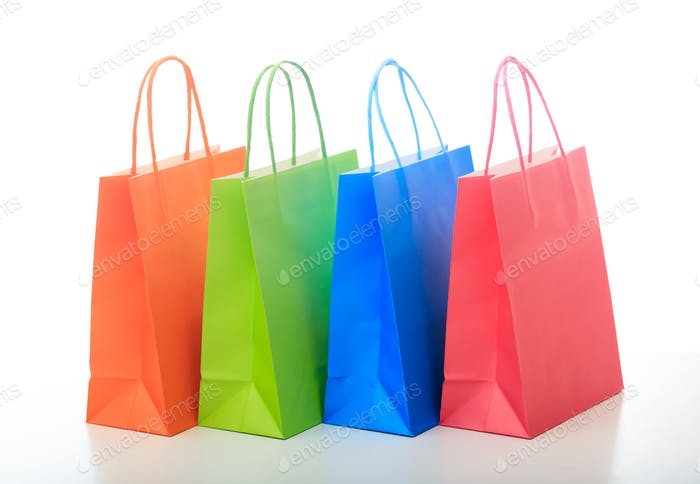 Colorful shopping bags on white background