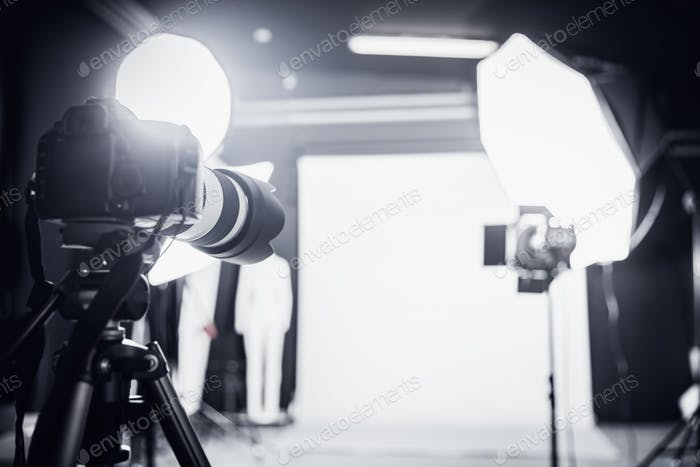 Large photo studio with professional lighting.
