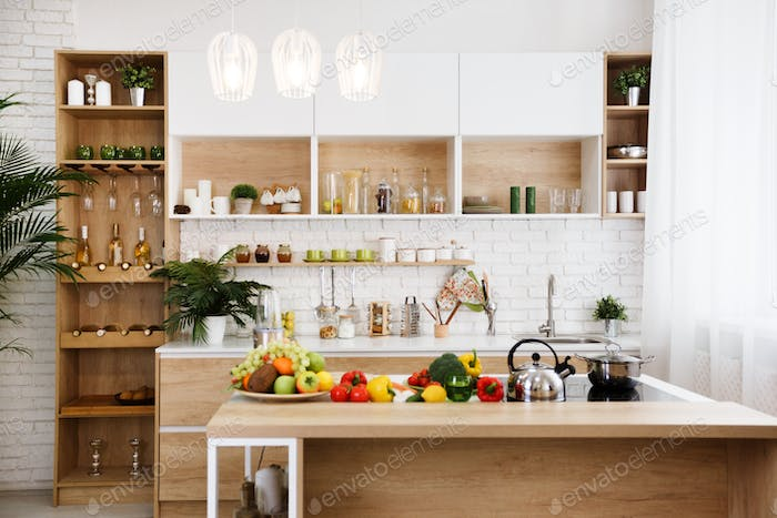 Wooden kitchen interior with island and big table