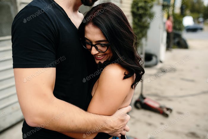 guy and girl in each other's arms