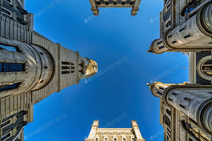 Uprisen angle of Philadelphia city hall with historic building over blue sky background