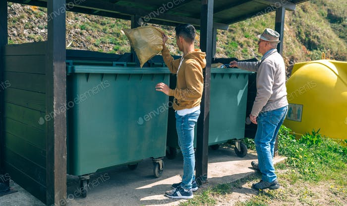 Men throwing garbage to container