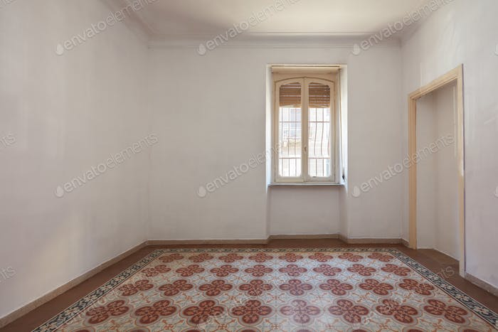 Empty room interior with tiled, decorated floor