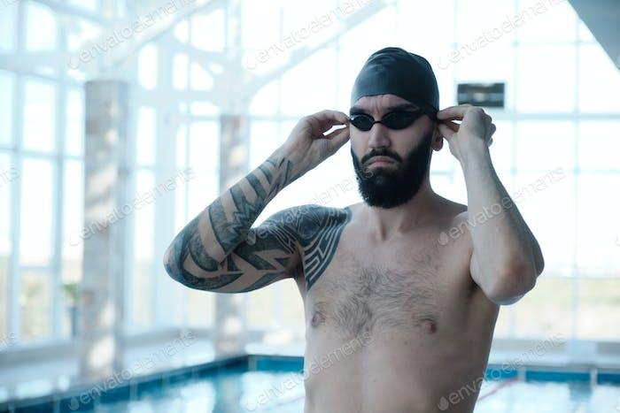 Bearded swimmer in pool