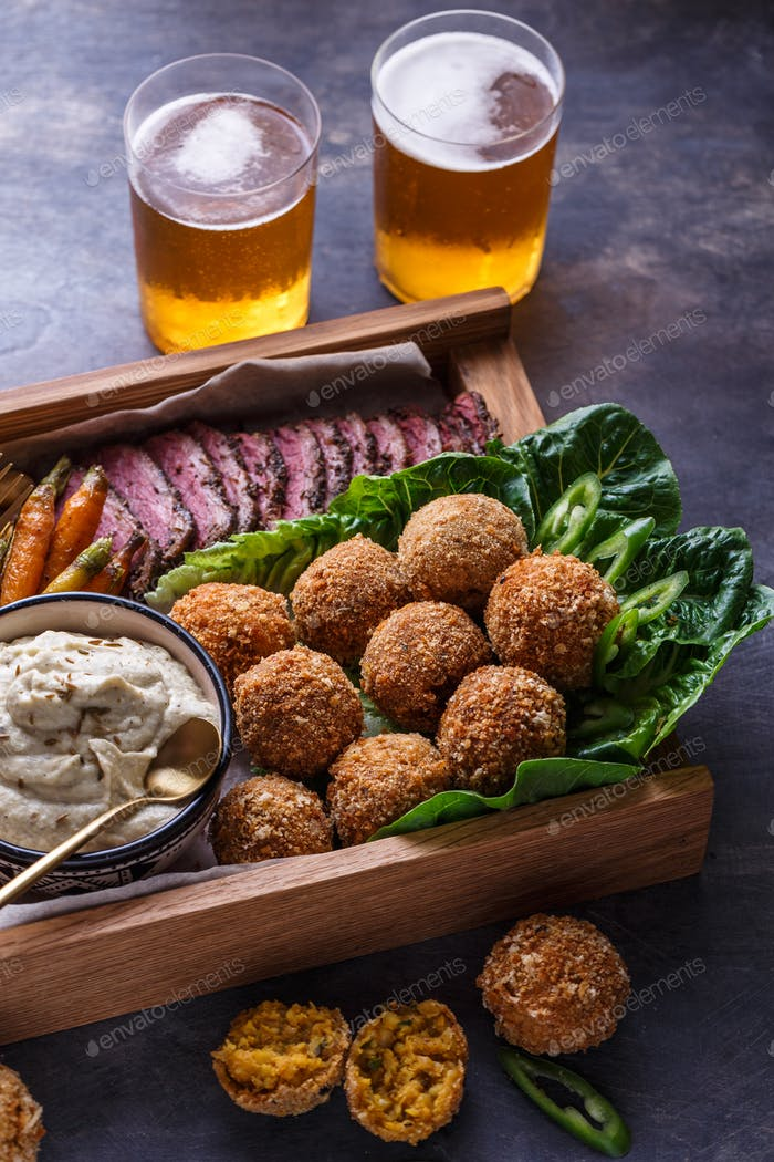 Falafel balls on a romano leafs in a wooden box