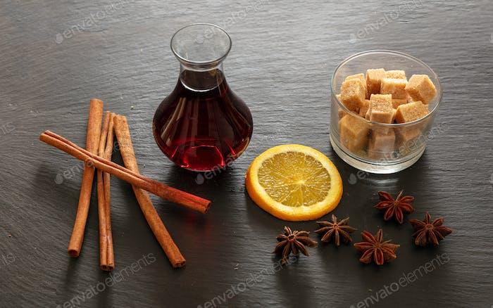 Mulled wine recipe ingredients, Christmas hot drink. Orange, cinnamon, star anise