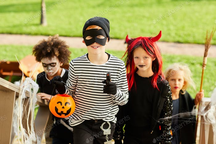 Boy Trick or Treating with Friends